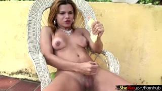 Redhead tranny shoves a thick melon slice up her tight ass