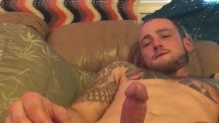 Tattooed sexy stud busting a nut