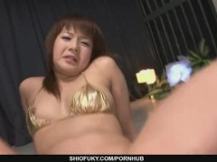 Bikini-clad brunette cutie pussy fondled and fucked with dildo
