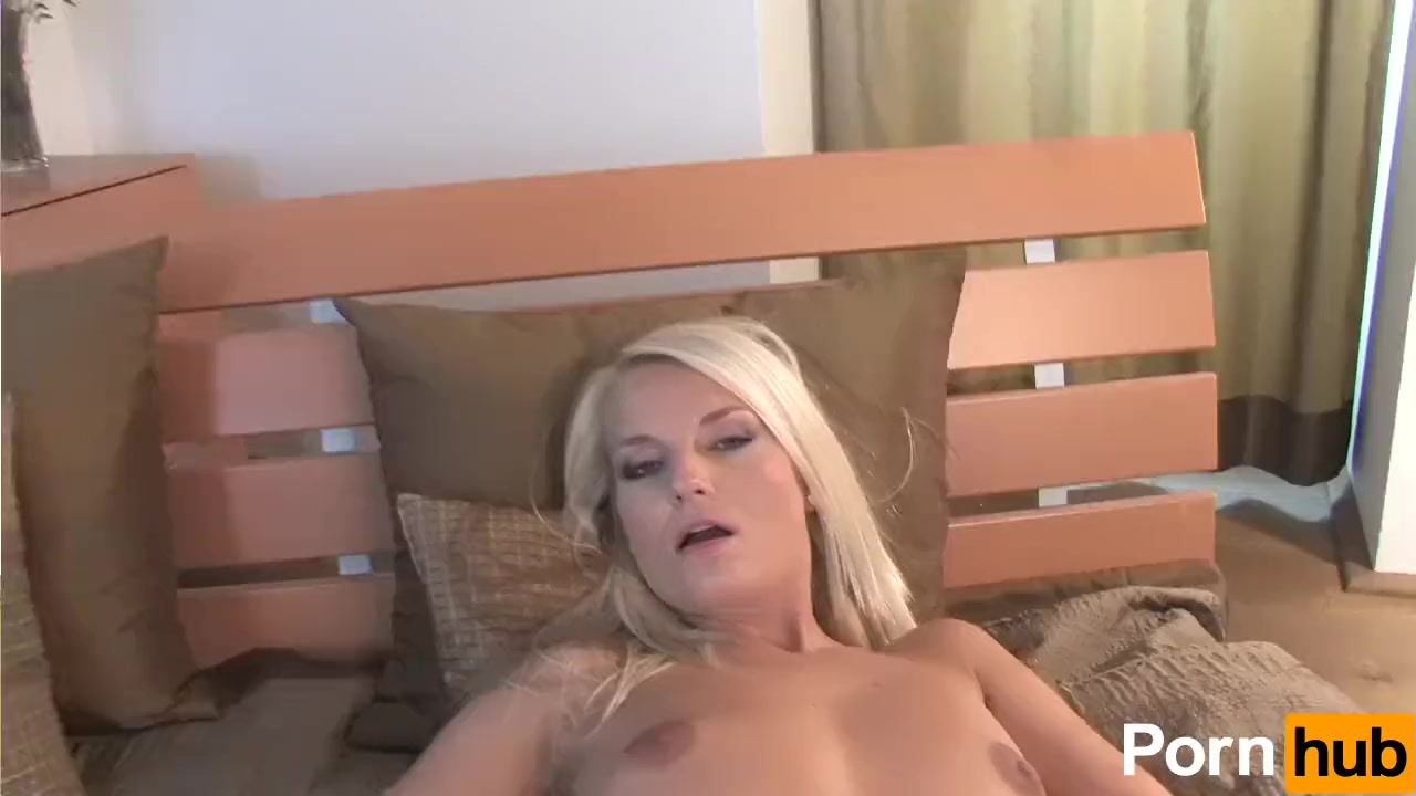 Horny blonde undresses and plays with her tight cunt