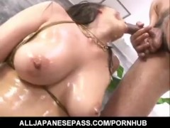 Japanese AV Model with huge oiled boobs is fucked and screams