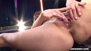 Asian stripper getting wild on the pole as she masturbates
