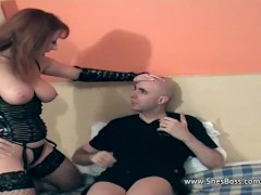Busty dominatrix redhead facesitting innocent guy