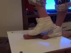 Girl in sneakers trample on cock and balls. Ends bootjob and cumshot