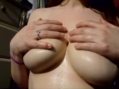 Playing with my Huge oiled up milk-filled Tits